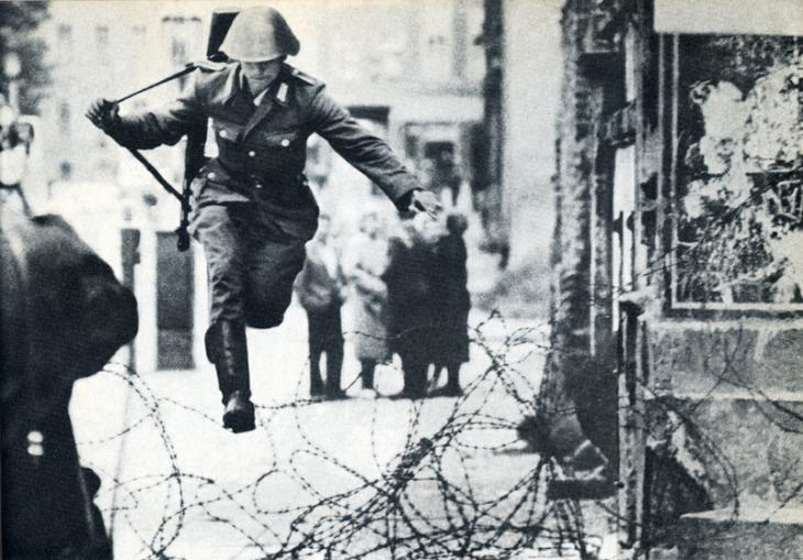 east german guard jumping the fence